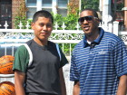 Spalding contest winner Carlos Mayorga, left, is pictured with Miami Heat guard Mario Chalmers. (Photo by Jim Mancari)