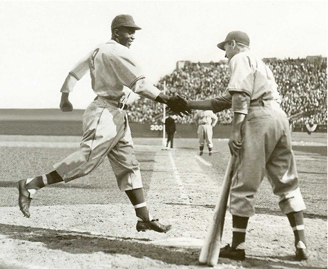Montreal Royals outfielder George Shuba, right, shakes Jackie Robinson's hand after the latter hit a home run on April 18, 1946 in Jersey City, N.J.  (Photo courtesy George Shuba Official Website)