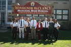 McClancy students, from left, Stephanie Vazquez, Daniel Ruiz, Myya Cox, Gurjeet Singh, Allyson Velazquez, William Musmacker, Alexander Piatkowski and Nathalie Lopez stand outside their new high school. (Photo by Tom Hopkins/Msgr. McClancy M.H.S.)