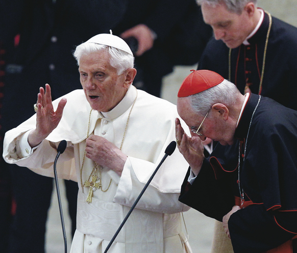 Pope Benedict XVI delivers his blessing during an audience with priests of the Diocese of Rome in Paul VI hall at the Vatican Feb. 14. At right is Cardinal Agostino Vallini, papal vicar of Rome.