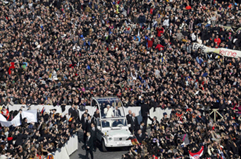 Pope Benedict XVI rides his popemobile through a St. Peter's Square at the Vatican during his last weekly audience.