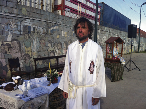 """Father Jose Maria di Paolo, """"Padre Pepe,"""" poses prior to Mass in the Villa 31 shanty of Buenos Aires, Argentina, March 17. The archdiocese made building chapels and serving people living in the shanties a priority during the administration of Cardinal Jorge Mario Bergoglio, now Pope Francis."""
