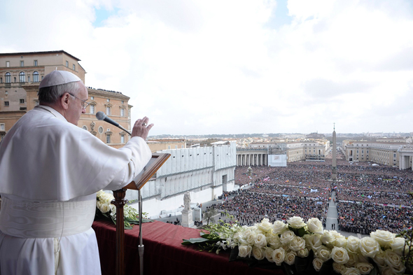 """Pope Francis delivers his Easter blessing """"urbi et orbi"""" (to the city and the world) from the central balcony of St. Peter's Basilica at the Vatican March 31."""