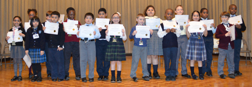 Participants in the regional primary math bee at Holy Angels Catholic Academy, Bay Ridge.