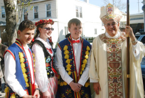Bishop DiMarzio greeted young people wearing traditional Polish attire and encouraged them to consider religious vocations.