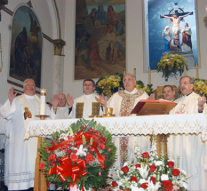 Bishop Nicholas DiMarzio celebrated the closing Mass of Holy Cross Church's centennial year on April 21. Above, from left, Msgr. Thomas Machalski,  who was raised in the parish; Msgr. John J. Strynkowski, former pastor; Father Witold Mroziewski, incoming pastor; Bishop DiMarzio; Deacon Jaime Varela, bishop's assistant; and Msgr. Peter W. Zendzian, pastor. Photos © Marie Elena Giossi