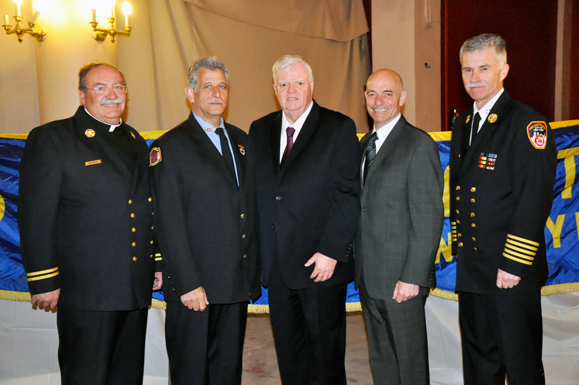 shown from left, are Msgr. John Delendick, chaplain; honoree retired Firefighter Robert Fraumeni of Gerritsen Beach; honoree Myles David, senior vice president, Lutheran Medical Center, Sunset Park; FDNY Commissioner Salvatore Cassano; and Chief of Department Edward Kilduff. At the breakfast, scholarship grants were presented to Bridget Sullivan and James Lunny.