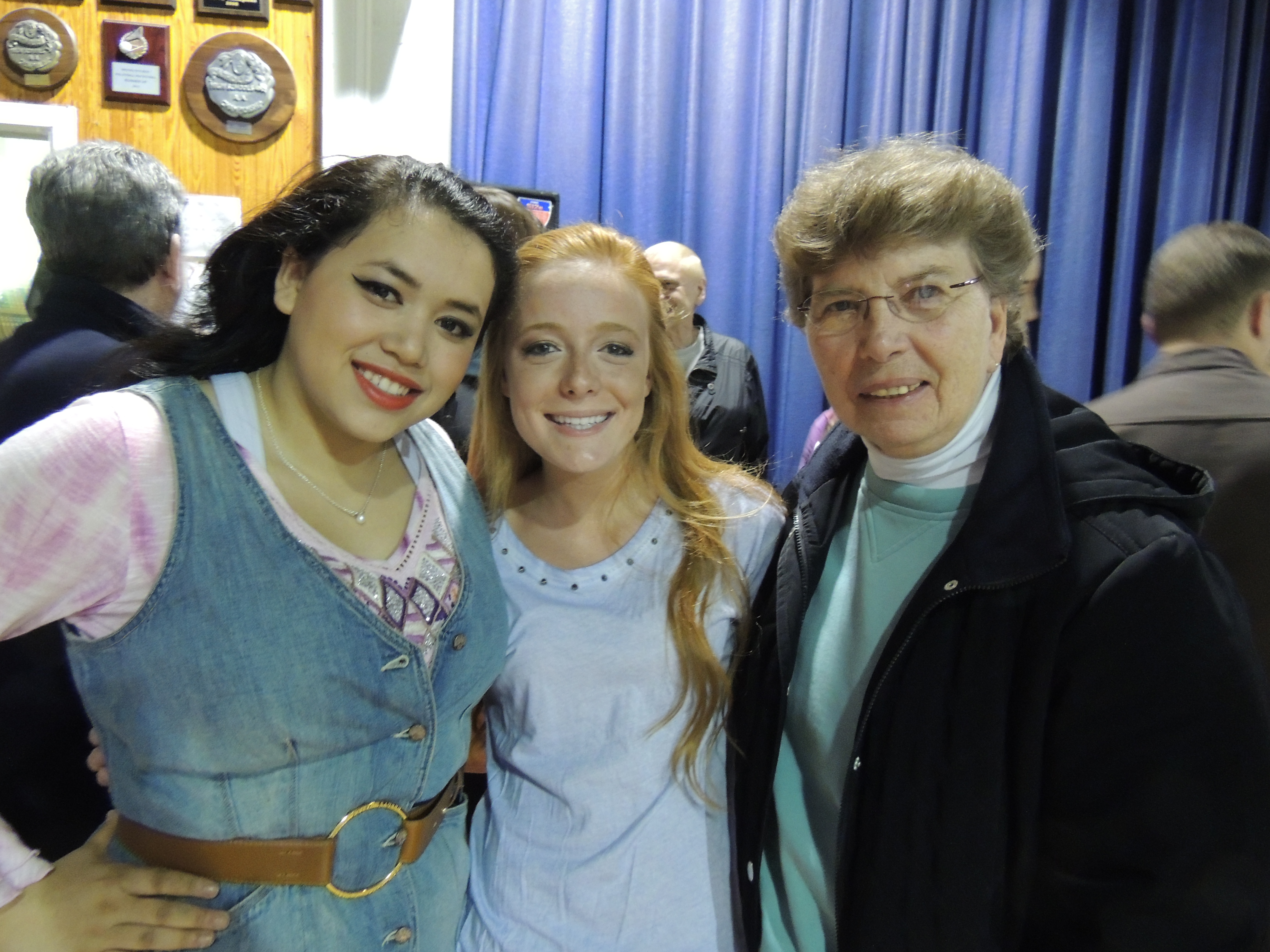 Seniors Nicolette Shin (Paulette) and Accursia Gallagher (Brooke) spend a moment with Sister Dolores Crepeau, C.S.J, principal, after the Saturday night performance.