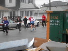 Even though the rebuilding process is ongoing, runners took to the streets of Breezy Point for the 33rd annual Buckley's-Kennedy's 5K Charity Race. (Photo by Jim Mancari)