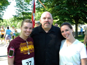 The family of Maj. Eugene McCarthy including, from left, Caitlin McCarthy, niece; Dennis McCarthy, brother; and Kerry O'Neil, niece, runs every year in the memorial 5K race. (Photo by Jim Mancari)
