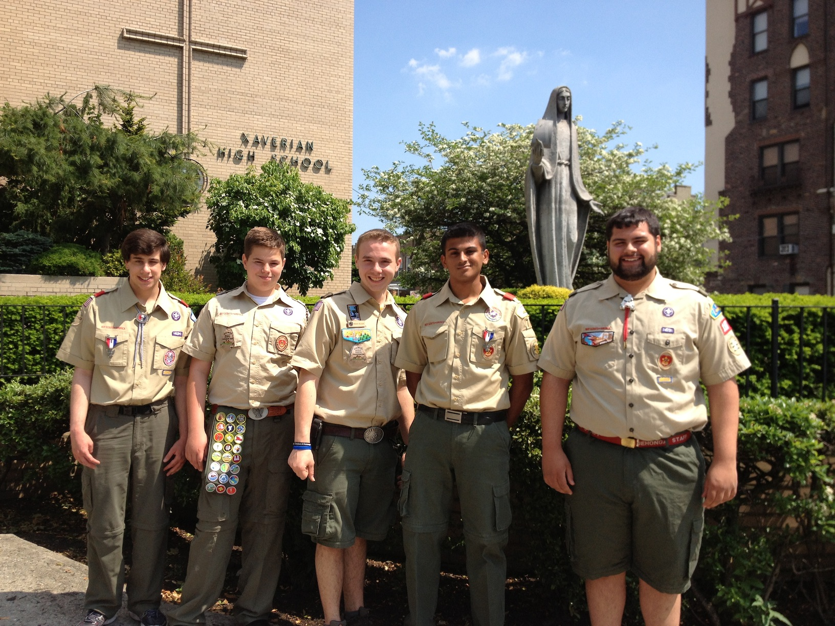 Eagle scouts, from left, Anthony Mecca, Peter Mosconi, Robert Buzzard, Raj Patel and Robert Rowley stand proud in their uniforms.