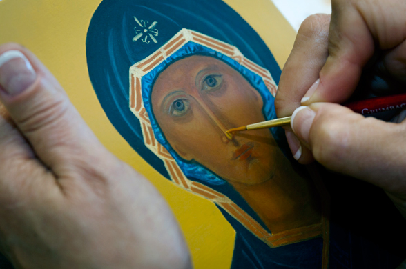 Teresa Foley paints detail on her icon of the Mother of God of the Sign May 25 at the home of iconographer Veronica Royal in Annandale, Va. Royal teaches iconography at her parish and home, promoting an ancient craft and infusing students with a sense of sacred art.