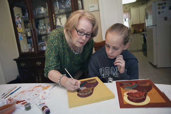 p Veronica Royal offers Lynn Vecchietti, 12, some advice on Vecchietti's icon of Our Lady of Tenderness at Royal's home.