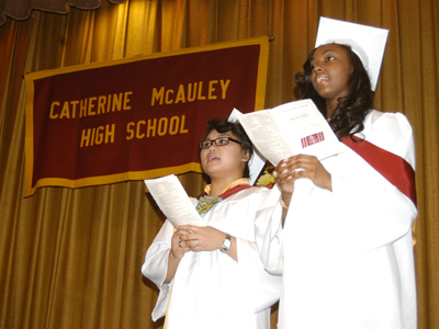 Catherine McAuley High School's Class of 2013 salutatorian Patra Grace Anano, left, and valedictorian Keshia Lamour, led peers in the school's alma mater.