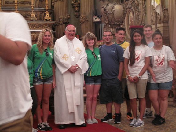 pilgrims from Brooklyn and Queens gather with Bishop Nicholas DiMarzio for Mass on their first day in Brazil.