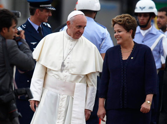 Pope Francis with Brazilian President Dilma Rousseff as he arrives at the international airport in Rio de Janeiro.
