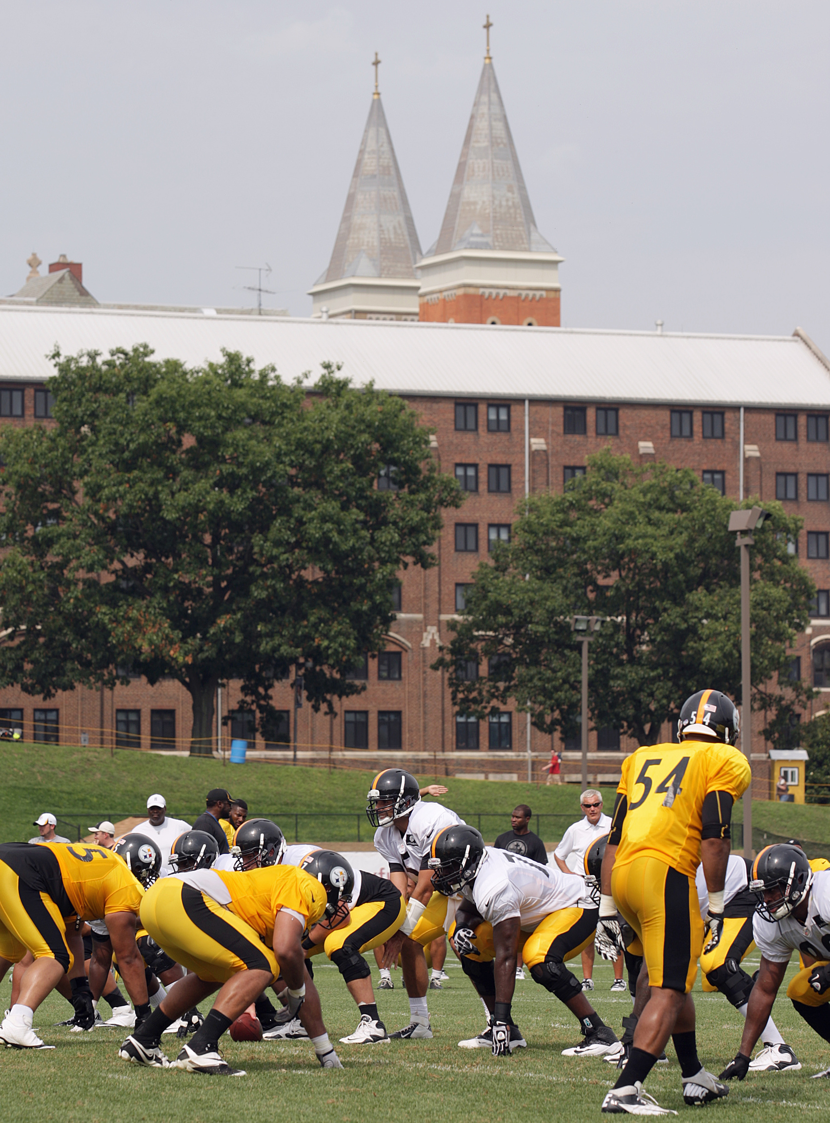 Steeples of St. Vincent Basilica seen in the distance during the Pittsburgh Steelers football training camp at Pennsylvania college
