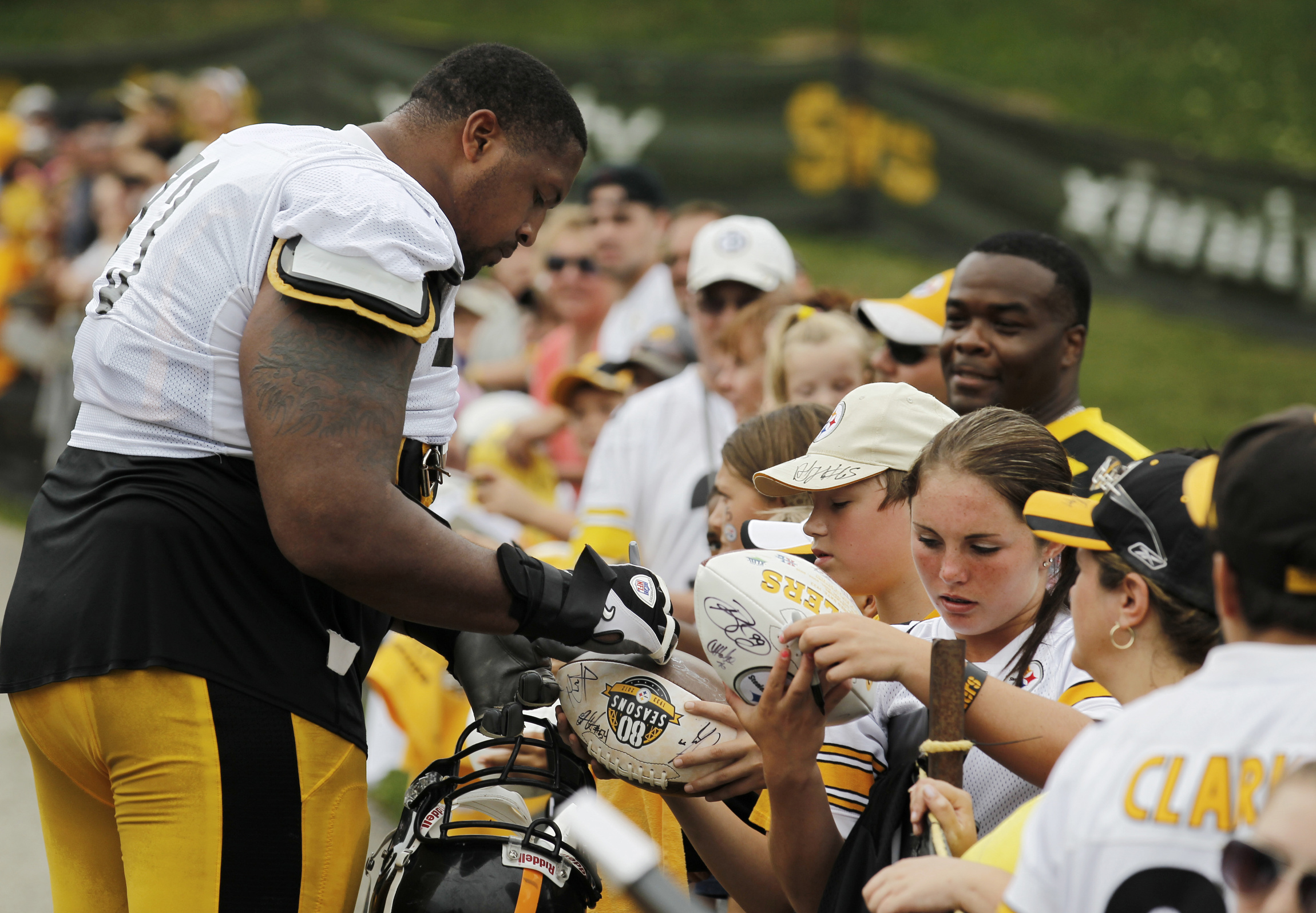 Pittsburgh Steelers offensive guard signs autographs after training session on campus of St. Vincent College in Pennsylvania