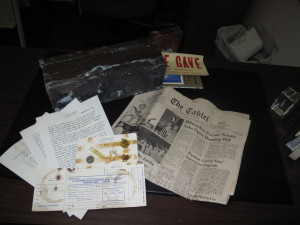 Contents of a time capsule buried in the former St. Aloysius School building in Ridgewood include an essay on the school's history, coins from the time, a donation card from the building campaign, and a copy of the Sept. 14, 1967 issue of The Tablet. (Photo by Antonina Zielinska)