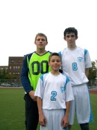 Danny Goncalves is pictured with a few of his taller teammates: senior goalie Robert Zawadzki, left, and sophomore midfielder/striker Brian Hickey, right. (Photo by Jim Mancari)