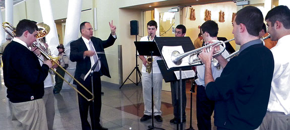 The band from Xaverian H.S., Bay Ridge, above, helped greet the Peace Light at JFK Airport.