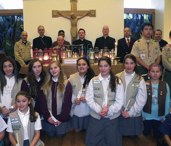 The Girl Scouts from St. Mel's parish, Flushing helped greet the Peace Light at JFK Airport.