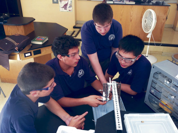 "The Nerd Herd is shown hard at work. The team is composed of seniors: Bryant Gonzaga, Minji Cho, Nicholas Cannizzo, Weiyan Lin, Joshua Alexander, Anthony LiBassi, Paolo Locsin and ""Sheldon"" the Robot."