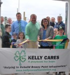 The ribbon cutting with the Kellys and Catholic Club President Keir Johnson.