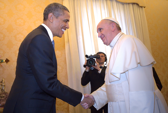 U.S. President Barack Obama shakes hands with Pope Francis during a private audience at the Vatican March 27.