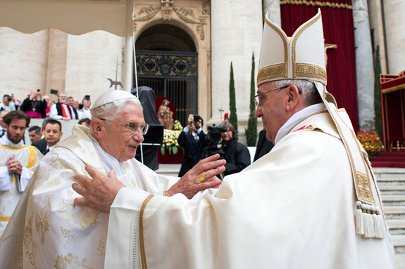 Retired Pope Benedict XVI embraces Pope Francis before the canonization Mass for SS. John XXIII and John Paul II in St. Peter's Square at the Vatican.