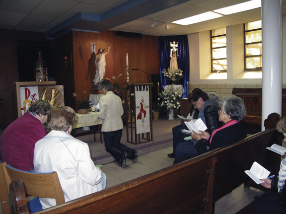 Mothers in Astoria gather in prayer for children at Our Lady of Mount Carmel Church.