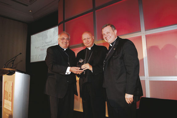 Archbishop Claudio Maria Celli accepts the St. Francis de Sales Award from Bishop Nicholas DiMarzio and Msgr. Kieran Harrington at the diocesan observance of World Communications Day.