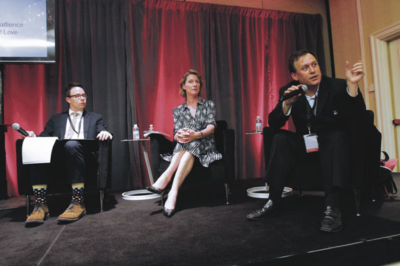 Panel members, from left, Grant Gallicho of Commonweal magazine; Tonia Ries of The Realtime Report; and John DeMarchi, founder and CEO of Social Czar, give some pointers on building audience participation.