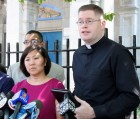 Father Patrick J. Keating, right, CEO of Catholic Migration Services, speaks at a press conference held by Congresswoman Grace Meng, left, outside Newtown H.S. in Elmhurst to urge undocumented immigrants to enroll and reapply for deferred action. (Photo by Jim Mancari)