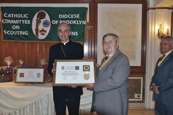 "Bishop Paul Sanchez presents the Ann Mannix Memorial Lifetime Achievement Award to Robert ""Beau"" Conlon of the Catholic War Veterans."