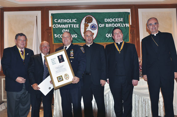 Brian Long of the Catholic Committee on Scouting, presents the Good Scout Award to Chief Owen J. Monaghan, NYPD commanding officer, Brooklyn South