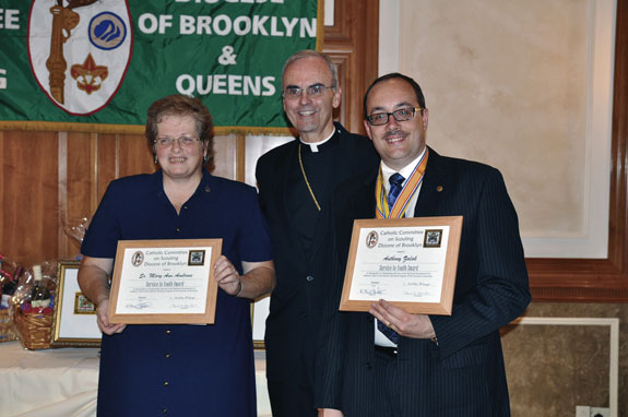 Bishop Paul Sanchez presents the Service to Youth Award to Sister Mary Ann Ambrose, C.S.J., Immaculate Heart of Mary parish, Windsor Terrace, and Anthony Salak, Our Lady of Hope, Middle Village.