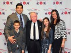 Former St. Francis Prep, Fresh Meadows, football standout Marco Battaglia, '91, is pictured at the Red & Blue Terrier Ring of Honor ceremony in March, 2014 with the school's alumni director, Brother Robert Kent, O.S.F., center, and his family: wife Maria, daughter Ava and son Marco Jr. (Photo courtesy Robert Johnston)