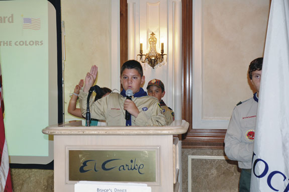 Boy Scout Brendan Cottingham of Holy Name, Park Slope, leads the recitation of the Scout Oath.