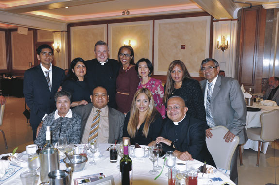 Msgr. Kieran Harrington, vicar for communications. posed with members of St. Joseph's Co-Cathedral parish, Prospect Heights, where he also is pastor.