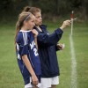 Archbishop Molloy H.S. girls' varsity soccer coach Judy Zink, right, is shown giving instructions to senior team co-captain Kelly Grogan, left. (Photo courtesy Judy Zink)