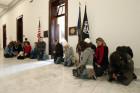 Pro-life supporters pray in hallway outside U.S. Senate Majority Leader Mitch McConnell's legislative office on Capitol Hill in Washington