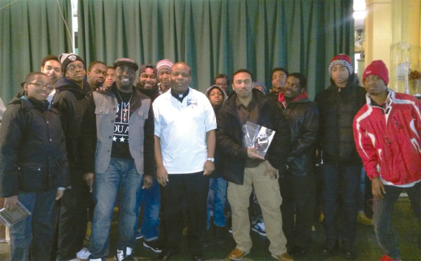 Author Carlos Wallace and Father Dwayne Davis rub elbows with diocesan youth at the Youth and Young Adult Leadership Conference sponsored by the diocesan Vicariate of Black Catholic Concerns.