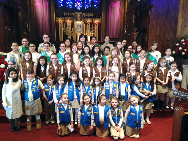 "On March 8, the St. Francis of Assisi Girl Scouts from Astoria, coordinated by Nancy Zotto, celebrated Girl Scout Sunday at the 9:30 a.m. Mass celebrated by pastor, Msgr. Ralph J. Maresca. Girl Scout Sunday is an annual event celebrated during Girl Scout Week, which honors the founding of the Girl Scouts by Juliette Gordon Low on March 12, 1912. It's a day set aside for Girl Scout Daisies, Brownies, Juniors, Cadettes, Seniors and Ambassadors ""to serve God,"" which is part of the Girl Scout promise. (Photo courtesy of Nancy Zotto)"