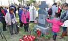 Parishioners from St. Peter Claver at Msgr. Quinn's grave