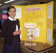 "Daniella Rodriguez, student from the sixth grade at St. Mary Gate of Heaven, Ozone Park, displays her ""Cupcake-O-Matic."" (Photos by Marie Elena Giossi)"