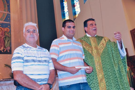 From left, Joseph Gugliara; his son, Filippo; and Msgr. David Cassato.