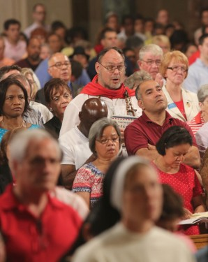 People pray during a  Mass on July 4, 2014 at the Basilica of the National Shrine of the Immaculate Conception in Washington on the final day of the U.S. bishops' Fortnight for Freedom campaign. (CNS photo/Bob Roller)
