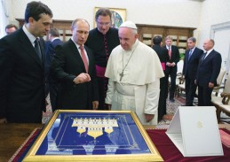 Russian President Vladimir Putin and Pope Francis exchange gifts during a private meeting at the Vatican June 10. (Photo © Catholic News Service/Maria Grazia Picciarella, pool)