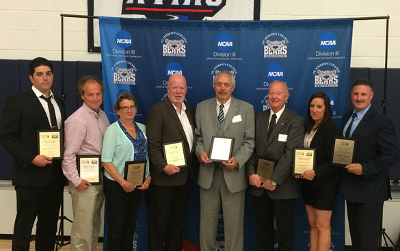 The first St. Joseph's College Hall of Fame class includes, from left, Luke Caccavo, Steve Somers, Laurie Barth, Tom Mohan (member, 1971-1972 men's basketball team), James Sullivan (coach, 1971-1972 men's basketball team), Tom Flahive (member, 1971-1972 men's basketball team), Mary Barry and Bobby Knapp. (Photo by Joe Moran)